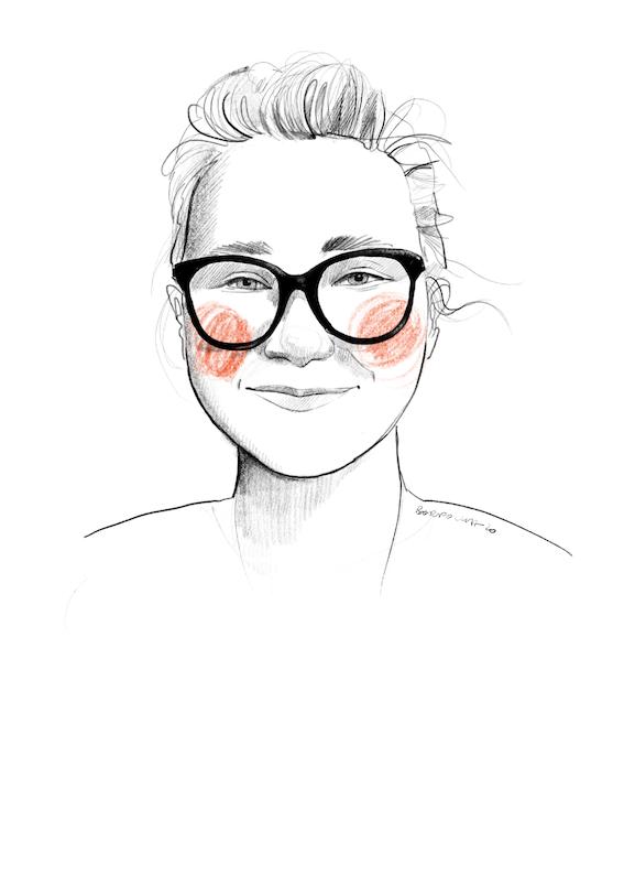 Narysowany czarnobiały portret Agaty. Ma związane z tyłu włosy i okulary z dużymi, ciemnymi oprawkami. Na policzkach zarysowane okrągłymi ruchami pomarańczowe rumieńce.
